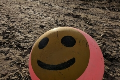 Happy-sailing-buoy-washed-up-on-beach